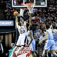 03 April 2015: San Antonio Spurs center Tiago Splitter (22) goes for the layup over Denver Nuggets forward Kenneth Faried (35) during the San Antonio Spurs 123-93 victory over the Denver Nuggets , at the AT&T Center, San Antonio, Texas, USA.