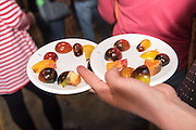 An attendee creates a  tomato taste testing plate to review the traits of the Indigo tomatoes.