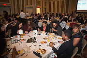 Attendees of the Martin Luther King Jr. Day brunch eat and mingle with one another on Jan. 16, 2017.