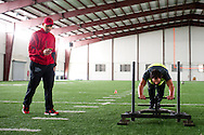 Johny Hendricks pushes the sled during circuit training while strength coach Adrian Ramirez keeps time at Kennedale High School in Kennedale, Texas on February 12, 2014.
