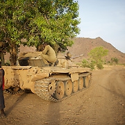 May 01, 2012 - Kauda, Nuba Mountains, South Kordofan, Sudan: Sudan People?s Liberation Movement (SPLA-N) rebel fighters fixe a war tank captured from Sudan's Armed Forces (SAF) during recent combats in the rebel-held territory of the Nuba Mountains in South Kordofan. ..SPLA-North, a historical ally of SPLA, South Sudan's former rebel forces, has since last June being fighting the Sudanese Army Forces (SAF) over the right to autonomy and of the end of persecution of Nuba people by the regime of President Bashir. (Paulo Nunes dos Santos/Polaris)