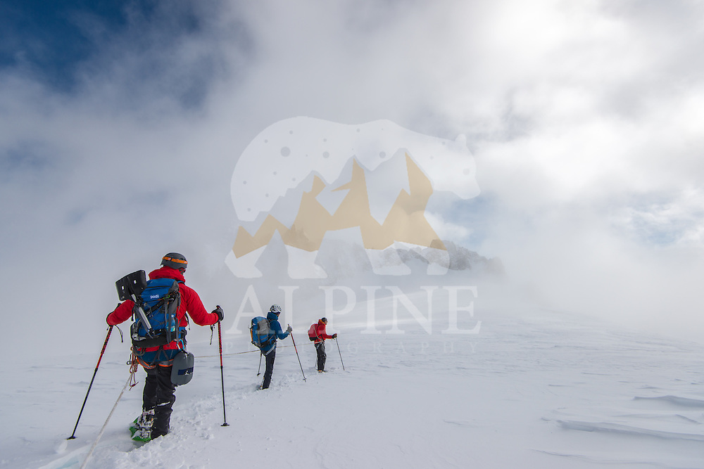 A group of mountaineers as seen during an approach to Aiguilles Marbrees on a cold and cloudy day in Mont Blanc Massif.