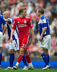 LIVERPOOL, ENGLAND - Saturday, April 23, 2011: Liverpool's Lucas Leiva clashes with Birmingham City's Lee Bowyer during the Premiership match at Anfield. (Photo by David Rawcliffe/Propaganda)