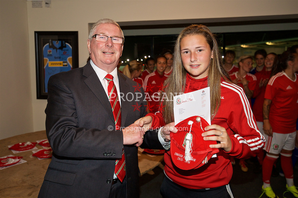 CARDIFF, WALES - Friday, August 19, 2016: Wales' Chloe Chivers is presented with her Under-19 cap by FAW President David Griffiths at Rodney Parade. (Pic by David Rawcliffe/Propaganda)