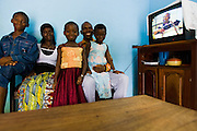 Members of the Djaha family in their home in Dimbokro, Cote d'Ivoire on Friday June 19, 2009. From left to right Henri Joel Djaha Kouakou, 11, Viviane M'Bra Affoue, 32, Alice Bienvenue Djaha Aya, 7, Barthelemy Djaha N'Gueran, 44 and Solange Djaha Ahou, 8. Both parents and the two youngest children are HIV-positive.