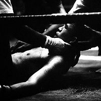 "Yangon, Myanmar May 2006<br /> Boxing fighters of the KLN boxing school. Most of them are part of the Karen minority ethnic group.<br /> On this picture: Boxer Htit Chone, 20 years old, finalist of the ""fly weight"" category during the final match that he had lost.<br /> Photo: Ezequiel Scagnetti"