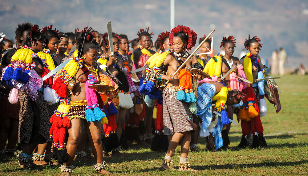 Ludzidzini, Swaziland, Africa - Annual Umhlanga, or reed dance ceremony, in which up to 100,000 young Swazi women gather to celebrate their virginity and honor the queen mother during the 8 day long event.<br /> Maidens led by princess dance before King Mswati III on day 7 of the ceremony