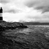 Les Eclaireurs Lighthouse is located just east of Ushuaia, Argentina in the Beagle Channel.  The lighthouse was put into service on December 23, 1920 and is still currently in operation.  Argentines refer to the lighthouse as the lighthouse at the end of the world.