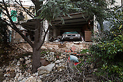 A car damaged by the eartquake abandoned in historical center city. On 6 April 2009 a strong earthquake hit the city of L'Aquila, in the central Abruzzo region of Italy, leaving 308 dead and tens of thousand homeless. 4  years after In the historical center of the city few signs of reconstructions could be seen. On the other hand the effects of the of abandonment add up to the destruction of the quake. .