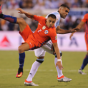 EAST RUTHERFORD, NEW JERSEY - JUNE 26:  Alexis Sanchez #7 of Chile challenges for the ball with Gabriel Mercado #4 of Argentina during the Argentina Vs Chile Final match of the Copa America Centenario USA 2016 Tournament at MetLife Stadium on June 26, 2016 in East Rutherford, New Jersey. (Photo by Tim Clayton/Corbis via Getty Images)