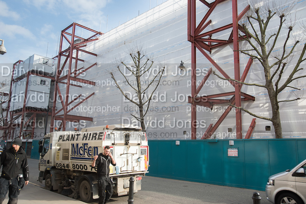 Trees being protected and facade during Demolition work Commercial St./ Brushfield St.  London. 29February 2016