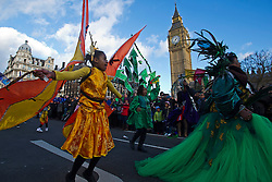 © London News Pictures. 01/01/2013. London, UK.  Dancers from the National Carnival Guild pass Big Ben as they take part in the 2012 New Years Parade through the centre London on January 1st, 2013. Photo credit : Ben Cawthra/LNP