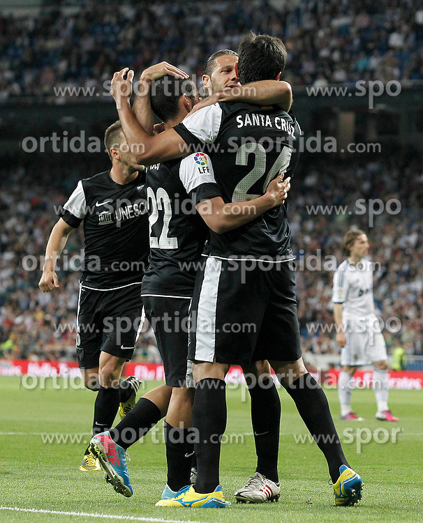 08.05.2013, Estadio Santiago Bernabeu, Madrid, ESP, Primera Division, Real Madrid vs FC Malaga, 36. Runde, im Bild Malaga's Isco (l), Martin Gaston Demichelis (c) and Roque Santa Cruz (r) celebrate goal // during the Spanish Primera Division 36th round match between Real Madrid CF and Malaga FC at the Estadio Santiago Bernabeu, Madrid, Spain on 2013/05/08. EXPA Pictures © 2013, PhotoCredit: EXPA/ Alterphotos/ Acero..***** ATTENTION - OUT OF ESP and SUI *****