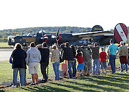 Montgomery, New York -  People line up along a fence to watch a B-24 Liberator bomber  from Collings Foundation getting ready to take off as part of the Wings of Freedom Tour at Orange County Airport on Oct. 2, 2010.