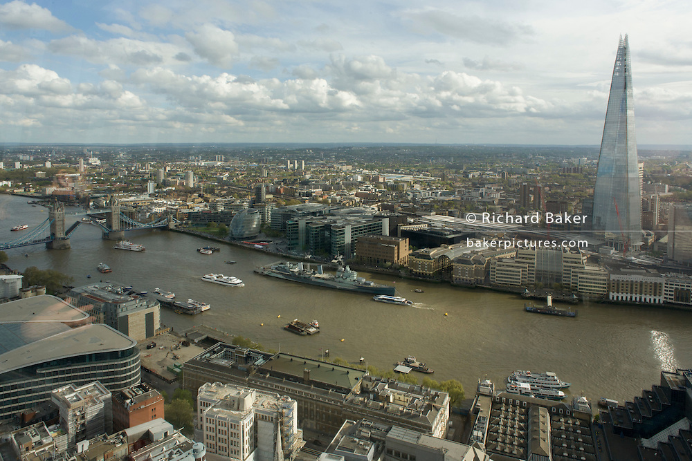 River Thames and southbank London skyline (The Shard, right) seen from the Sky Garden of the Walkie Talkie building in the City of London.