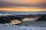 Nightshot with a view over Bigset, Hareid and Sula in the background. Snow in the montains, full moon, and colorful skies | Nattbilde med utsikt over Bigset, Hareid og Sula i bakgrunnen. Snø i fjellene, fullmåne, og fargerike skyer.