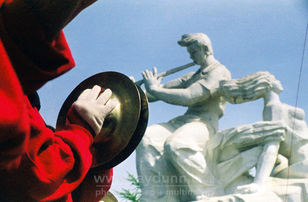 China, Taiyuan, 2008. A traditional drum and cymbal troupe performs their thundering music before the great triumphalist monument at Taiyuan's Wuyi Square, named for the May 1st Worker's Day.