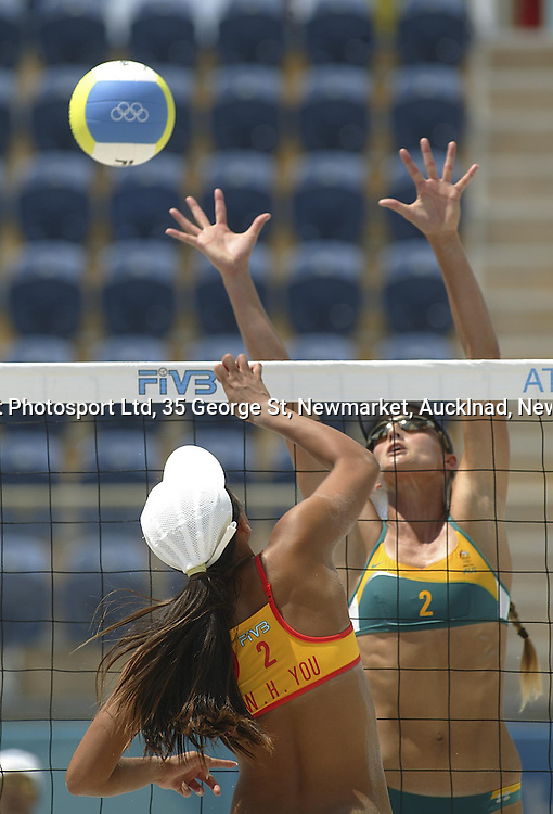 China's Wenhui You and Australia's Nicole Sanderson in the  Womens Beach Volleyball match between China and Australia during the Olympic Games, Athens, Greece. 16 August 2004<br />PHOTO: Barry Bland/PHOTOSPORT