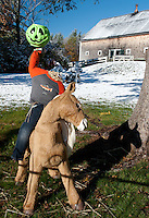 This headless horseman enjoys the sparkle that an early season snowfall brought to the region last evening.  (Karen Bobotas/for the Laconia Daily Sun)