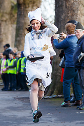 © Licensed to London News Pictures. 28/02/2017. London, UK. SEEMA KENNEDY MP races against Lords and members of media at the annual Rehab Parliamentary Pancake Race outside the Parliament on Shrove Tuesday, 28 February 2017. Photo credit: Tolga Akmen/LNP
