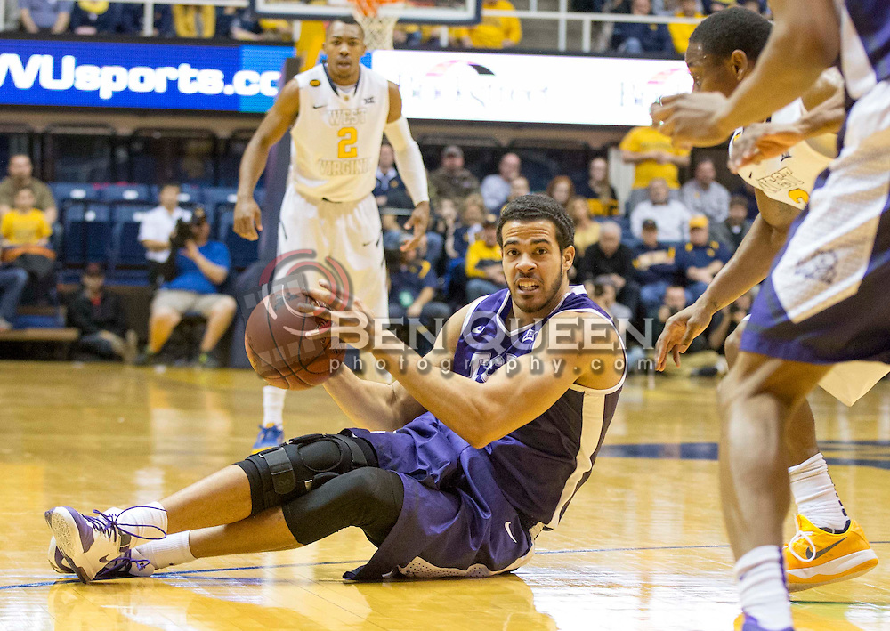 TCU Horned Frogs forward Amric Fields (4) passes the ball to a teammate against the West Virginia Mountaineers during the first half at the WVU Coliseum.