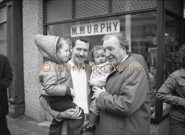 Image of Fianna Fáil leader Charles Haughey touring West Cork during his 1982 election campaign...04/02/1982.02/04/82.4th February 1982..Children of the nation:..Charles Haughey poses here for a photograph with Peter Farrelly and his children, 4 year old Mark  and Lorna who is not yet 2.  The Farrelly family live in Bantry.