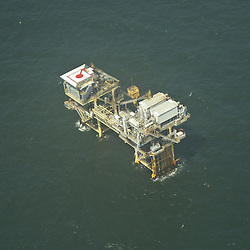 An aerial view of a rig in the Gulf of Mexico off the Louisiana Coast on Saturday, May 1, 2010.
