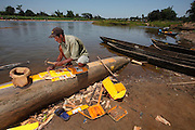Village scenes. Man repairing boat near Mahanaro. Madagascar. Photo - Zute Lightfoot)