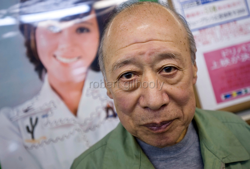 Porn star Shigeo Tokuda, 77, poses for a photo in front of movie posters outside a small cinema in Tokyo, Japan on 17 Oct. 2011. Photograph: Robert Gilhooly