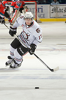 KELOWNA, CANADA, NOVEMBER 9: Chad Robinson #17 of the Red Deer Rebels skates for the puck during warm up as the Red Deer Rebels visit the Kelowna Rockets  on November 9, 2011 at Prospera Place in Kelowna, British Columbia, Canada (Photo by Marissa Baecker/Shoot the Breeze) *** Local Caption ***