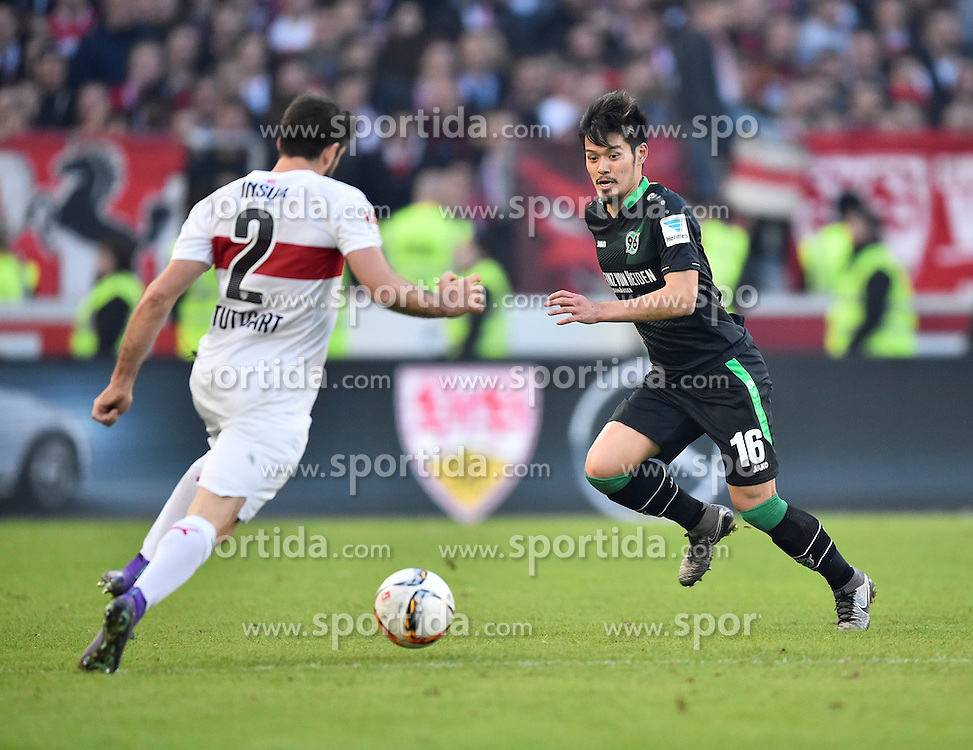 27.02.2016, Mercedes Benz Arena, Stuttgart, GER, 1. FBL, VfB Stuttgart vs Hannover 96, 23. Runde, im Bild Emiliano Insua VfB Stuttgart (links) gegen Hotaru Yamaguchi Hannover 96 (rechts) vor Logo VfB // during the German Bundesliga 23th round match between VfB Stuttgart and Hannover 96 at the Mercedes Benz Arena in Stuttgart, Germany on 2016/02/27. EXPA Pictures &copy; 2016, PhotoCredit: EXPA/ Eibner-Pressefoto/ Weber<br /> <br /> *****ATTENTION - OUT of GER*****