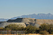 Strip mines for harvesting copper in Sahuarita and Green Valley, Arizona, USA, line the floor of the Sonoran Desert to the west of the Santa Rita Mountains.  The eastern slope on the other side of the mountains is the site of the proposed Rosemont copper mine.