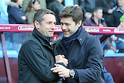 Aston Villa Manager Remi Garde and Tottenham Hotspur Manager Mauricio Pochettino  during the Barclays Premier League match between Aston Villa and Tottenham Hotspur at Villa Park, Birmingham, England on 13 March 2016. Photo by Simon Davies.
