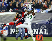 New York Jets cornerback Darrelle Revis (24) breaks up a pass play intended for Buffalo Bills wide receiver Terrell Owens (81) during the NFL football game against the Buffalo Bills, December 3, 2009 in Toronto, Canada. The Jets won the game 19-13. ©Paul Anthony Spinelli