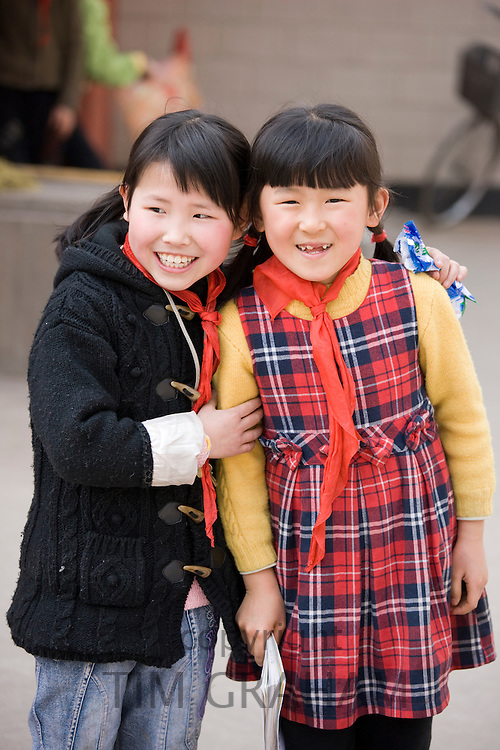 Girls in the playground of a primary school in Hong Ying Road, Xian. China has a one child policy to limit population.