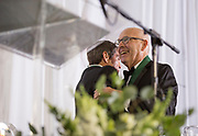 Larry Starr, left, and William Hilyard embrace at the Alumni Awards Gala on October 6, 2017. Hilyard received the Distinguished Service Award.