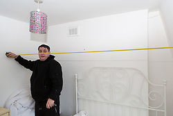 Antony Zomparelli measures the box room for which he is expected to pay an additional £360,000 after bought his two bedroom Islington flat through Right-To-Buy in 2014 for £340,000. He has now been asked to pay more than twice the price for his home after the council mistakenly sold it to him as a one bedroom flat, the small 8ft x 8ft box room being considered a second bedroom. London, February 04 2019.