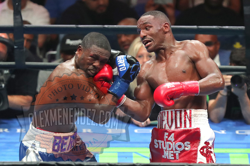 Devon Alexander lands an uppercut to the face of Andre Berto during a Premier Boxing Champions fight on Saturday, August 4, 2018 at the Nassau Veterans Memorial Coliseum in Uniondale, New York.  (Alex Menendez via AP)