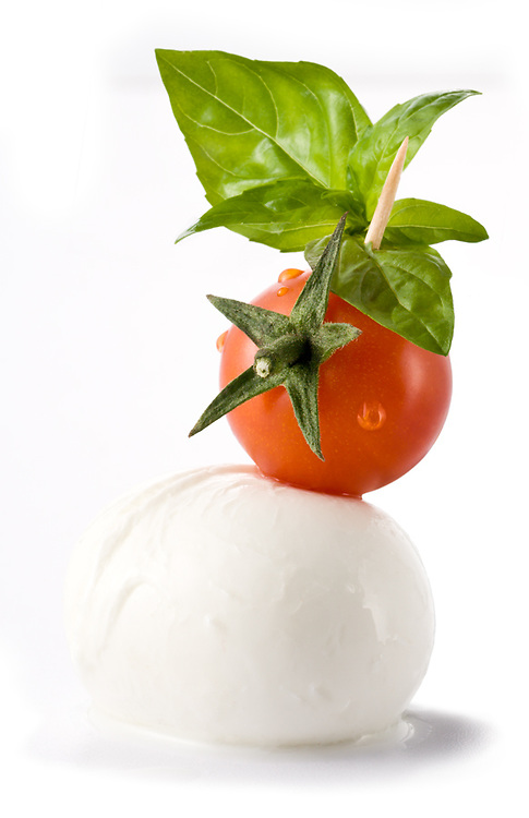 mozzarella tomato and basil on a skewer as an italian banner