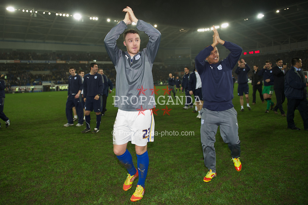 CARDIFF, WALES - Tuesday, January 24, 2012: Cardiff City's Darcy Blake and Robert Earnshaw celebrate their side's penalty shoot-out victory over Crystal Palace during the Football League Cup Semi-Final 2nd Leg at the Cardiff City Stadium. (Pic by David Rawcliffe/Propaganda)