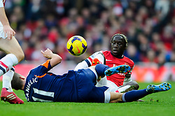 Fulham Midfielder Alex Kacaniklic (SWE) is tackled by Arsenal Defender Bacary Sagna (FRA) whose studs are showing  during the match - Photo mandatory by-line: Rogan Thomson/JMP - Tel: Mobile: 07966 386802 - 18/01/14 - SPORT - FOOTBALL - Emirates Stadium - Arsenal v Fulham - Barclays Premier League.