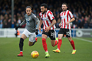 Lincoln City Midfielder Nathan Arnold on the attack Coventry City Midfielder Jodi Jones gives chase during the EFL Sky Bet League 2 match between Lincoln City and Coventry City at Sincil Bank, Lincoln, United Kingdom on 18 November 2017. Photo by Craig Zadoroznyj.