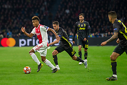 10-04-2019 NED: Champions League AFC Ajax - Juventus,  Amsterdam<br /> Round of 8, 1st leg / Ajax plays the first match 1-1 against Juventus during the UEFA Champions League first leg quarter-final football match / David Neres #7 of Ajax, Miralem Pjanic #5 of Juventus