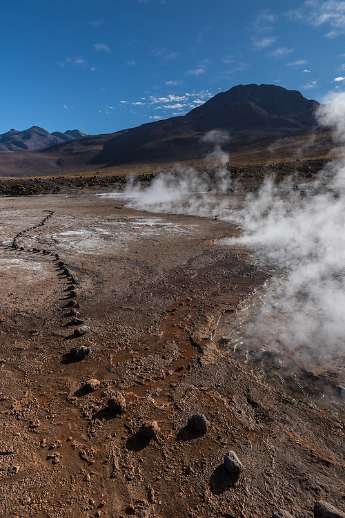 Water evaporates and creates steam in the El Tatio geyser field, El Tatio, Chile