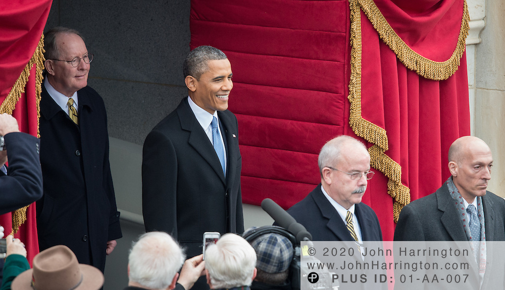 President Obama, escorted by Sergeant at Arms Terrence Gainer (front) and Sen. Lamar Alexander (rear) arrives at the 57th Presidential Inauguration of President Barack Obama at the U.S. Capitol Building in Washington, DC January 21, 2013.