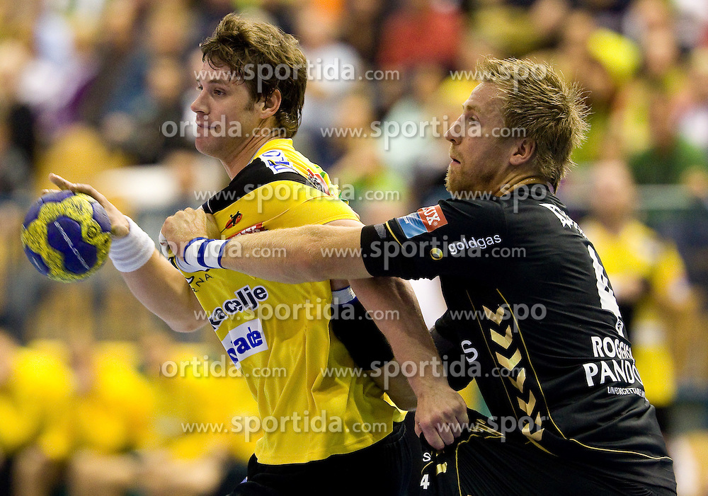 Momir Rnic (#22) of Celje vs Oliver Roggisch (#4) of RNL during Velux EHL Champions league 2010/2011 Group A men handball match between HC Celje Pivovarna Lasko of Slovenia and Rhein-Neckar Loewen of Germany, on October 2, 2010 in Arena Zlatorog, Celje, Slovenia. Rhein-Neckar Löwen defeated Celje Pivovarna Lasko 32 - 28. (Photo By Vid Ponikvar / Sportida.com)