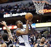 Dallas Mavericks point guard Darren Collison (4) loses the ball during a layup against the San Antonio Spurs at American Airlines Center in Dallas, Texas, on January 25, 2013.  (Stan Olszewski/The Dallas Morning News)