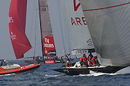 France's Areva Challenge leads Emirates Team Zealand as they tack back upwind during America's Cup fleet racing; Valencia, Spain.