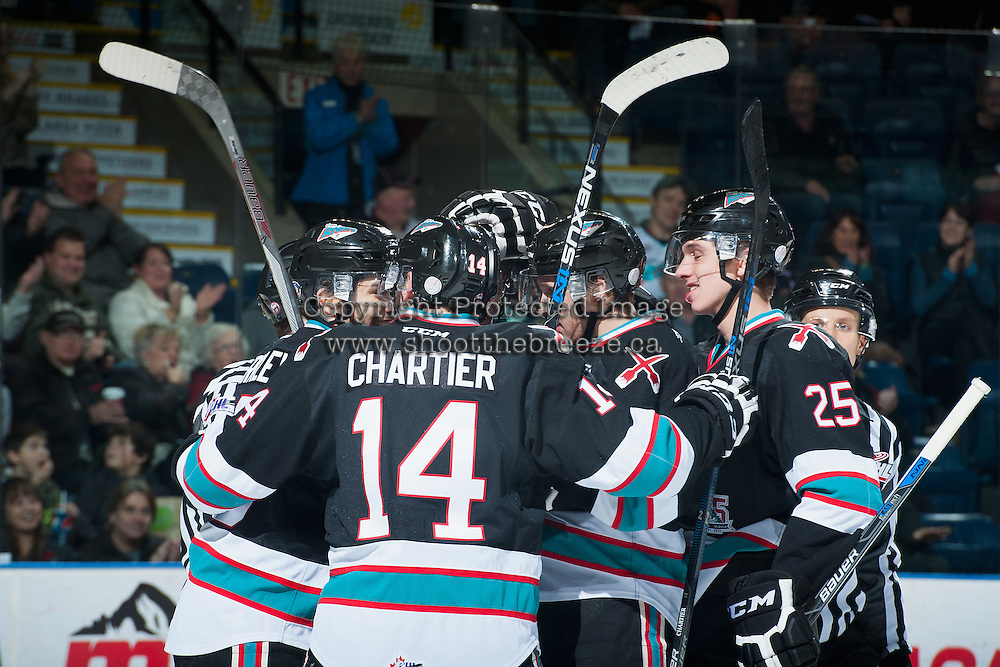 KELOWNA, CANADA - DECEMBER 2: Rourke Chartier #14 of Kelowna Rockets celebrates a goal with teammates during the first period against the Kootenay Ice on December 2, 2015 at Prospera Place in Kelowna, British Columbia, Canada.  (Photo by Marissa Baecker/Shoot the Breeze)  *** Local Caption *** Rourke Chartier;
