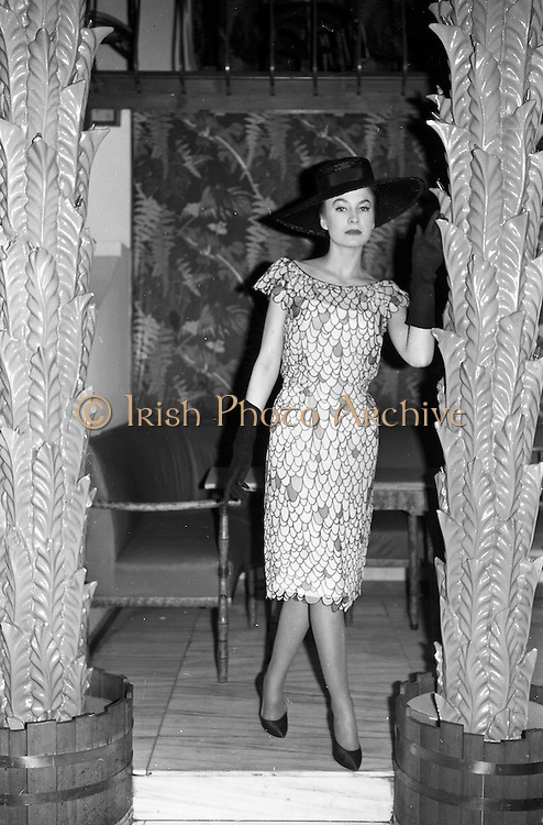 12/02/1963<br /> 02/12/1963<br /> 12 February 1963<br /> Irene Gilbert Fashion show at the Gresham Hotel, Dublin. Picture shows &quot;Blissful&quot; white/black crepe chiffon cocktail dress.